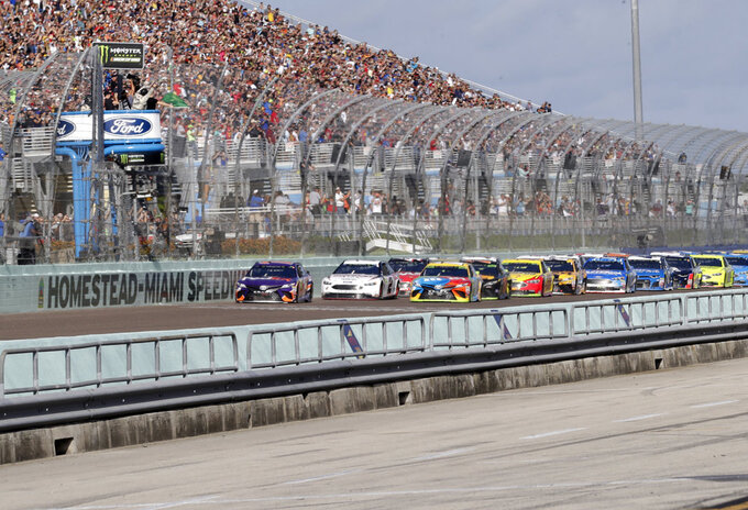 Car get the green flag during the start of the NASCAR Series Championship auto race at the Homestead-Miami Speedway, Sunday, Nov. 18, 2018, in Homestead, Fla. (AP Photo/Lynne Sladky)