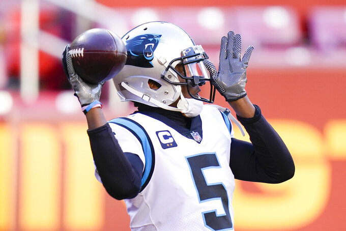 Carolina Panthers quarterback Teddy Bridgewater (5) warming up before the start of an NFL football game against the Washington Football Team, Sunday, Dec. 27, 2020, in Landover, Md. (AP Photo/Carolyn Kaster)