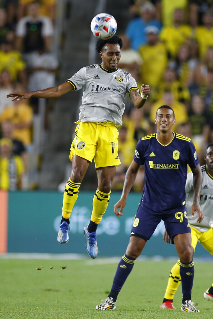 Columbus Crew's Marlon Hairston, left, heads the ball in front of Nashville SC's Jhonder Cadiz during the second half of an MLS soccer match Wednesday, July 21, 2021, in Columbus, Ohio. The game ended in a draw. (AP Photo/Jay LaPrete)