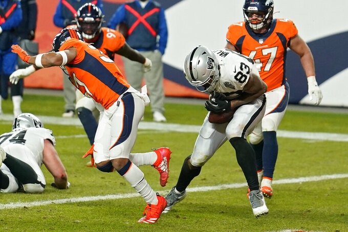 Las Vegas Raiders tight end Darren Waller (83) makes a catch in the endzone for a 2-point conversion against the Denver Broncos during the second half of an NFL football game, Sunday, Jan. 3, 2021, in Denver. (AP Photo/Jack Dempsey)