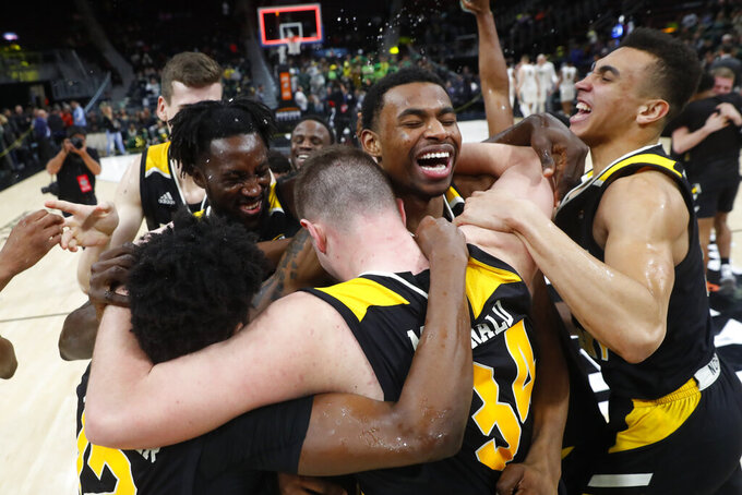 Northern Kentucky players celebrate their 77-66 win against Wright State in an NCAA college basketball game for the Horizon League men's tournament championship in Detroit, Tuesday, March 12, 2019. (AP Photo/Paul Sancya)