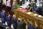 Venezuela's new National Electoral Council directors are sworn in during an extraordinary session at the National Assembly in Caracas, Venezuela, Tuesday, May 4, 2021. The National Assembly, with an overwhelming pro-government majority, on Tuesday appointed two recognized opponents as members of the new board of the National Electoral Council of Venezuela. (AP Photo/Ariana Cubillos)