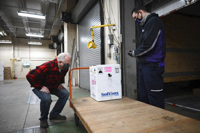 Minnesota Gov. Tim Walz inspects the first delivery of the Pfizer-BioNTech COVID-19 vaccines to the Minneapolis VA Hospital Monday, Dec. 14, 2020. (Aaron Lavinsky/Star Tribune via AP, Pool)