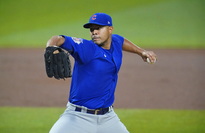 FILE - In this Sept. 22, 2020, file photo, Chicago Cubs starting pitcher Jose Quintana delivers during the first inning of the team's baseball game against the Pittsburgh Pirates in Pittsburgh. Quintana has agreed to a $8 million, one-year contract with the Los Angeles Angels, a person familiar with the negotiations told The Associated Press on Tuesday night, Jan. 19, 2021. The person spoke on condition of anonymity because the agreement is subject to a successful physical. (AP Photo/Gene J. Puskar, File)