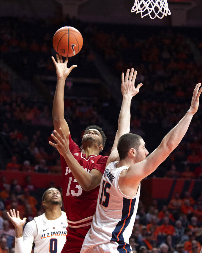 Indiana forward Juwan Morgan (13) shoots between the defense of Illinois guard Alan Griffin (0) and forward Giorgi Bezhanishvili (15) during the second half of an NCAA college basketball game in Champaign, Ill., Thursday, March 7, 2019. (AP Photo/Stephen Haas)