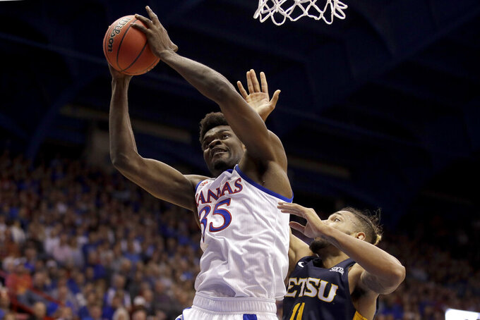 Kansas center Udoka Azubuike (35) beats East Tennessee State forward Jeromy Rodriguez (11) to a rebound during the first half of an NCAA college basketball game Tuesday, Nov. 19, 2019, in Lawrence, Kan. (AP Photo/Charlie Riedel)
