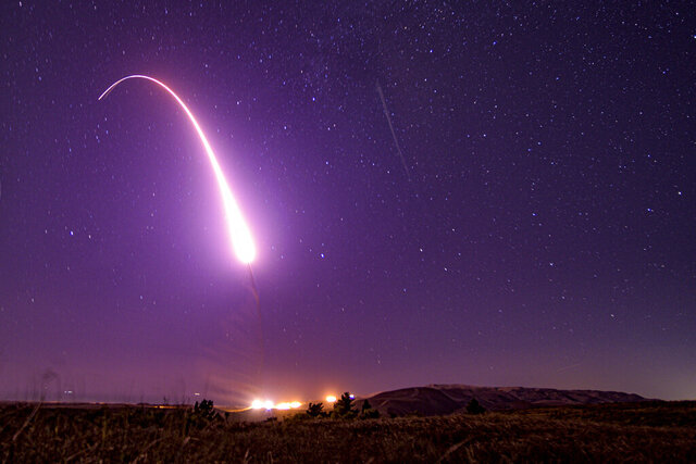 This image taken with a slow shutter speed on Oct. 2, 2019, and provided by the U.S. Air Force shows an unarmed Minuteman 3 intercontinental ballistic missile test launch at Vandenberg Air Force Base, Calif. The Pentagon has raised to $95.8 billion the estimated cost of fielding a new fleet of land-based nuclear missiles to replace the Minuteman 3 (Staff Sgt. J.T. Armstrong/U.S. Air Force via AP)
