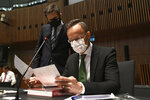 Hungarian Foreign Affairs and Trade Minister Peter Szijjarto looks at paper work, during a European general affairs ministers meeting at the European Council building in Luxembourg, Tuesday, June 22, 2021. (John Thys/Pool Photo via AP)