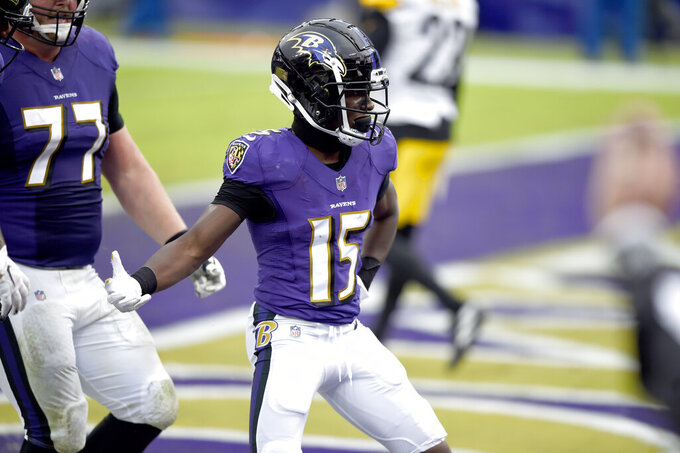 Baltimore Ravens wide receiver Marquise Brown reacts after catching a touchdown pass from quarterback Lamar Jackson, not visible, during the second half of an NFL football game against the Pittsburgh Steelers, Sunday, Nov. 1, 2020, in Baltimore. (AP Photo/Gail Burton)