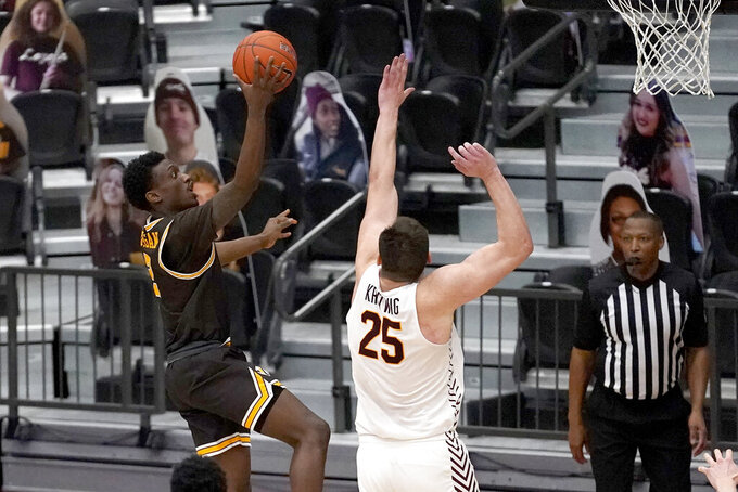 Valparaiso's Zion Morgan, left, shoots over Loyola Chicago's Cameron Krutwig during the second half of an NCAA college basketball game Wednesday, Feb. 17, 2021, in Chicago. Loyola Chicago won 54-52. (AP Photo/Charles Rex Arbogast)