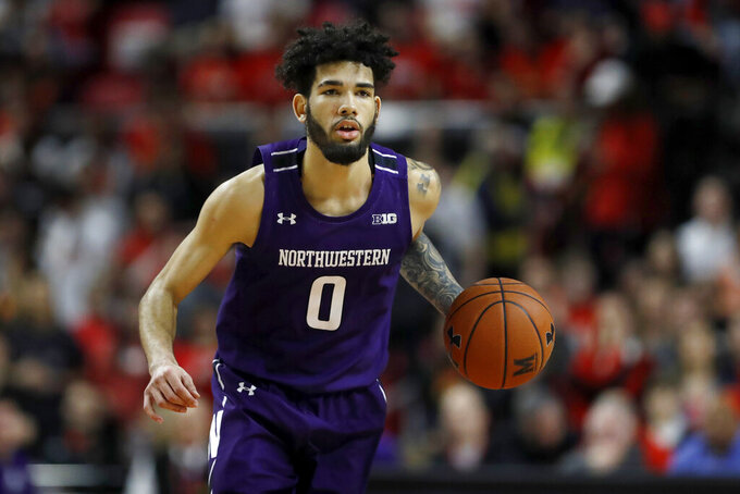 Northwestern guard Boo Buie dribbles up court against Maryland during the first half of an NCAA college basketball game, Tuesday, Feb. 18, 2020, in College Park, Md. (AP Photo/Julio Cortez)