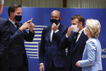 From left, Dutch Prime Minister Mark Rutte, European Council President Charles Michel, French President Emmanuel Macron and European Commission President Ursula von der Leyen attend a round table meeting at an EU summit in Brussels, Tuesday, July 21, 2020. Weary European Union leaders finally clinched an unprecedented budget and coronavirus recovery fund early Tuesday, finding unity after four days and as many nights of fighting and wrangling over money and power in one of their longest summits ever. (Stephanie Lecocq, Pool Photo via AP)