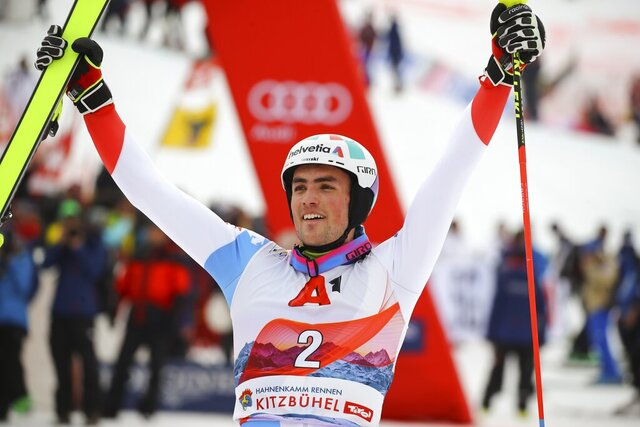 Switzerland's Daniel Yule celebrates winning an alpine ski, men's World Cup slalom, in Kitzbuehel, Austria, Sunday, Jan. 26, 2020. (AP Photo/Marco Trovati)