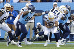 Tennessee Titans defensive lineman Jeffery Simmons (98) sacks Los Angeles Chargers quarterback Philip Rivers (17) for a 3-yard loss in the second half of an NFL football game Sunday, Oct. 20, 2019, in Nashville, Tenn. (AP Photo/James Kenney)