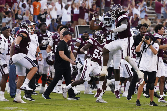 Mississippi State players celebrate their 35-34 win over Louisiana Tech during their NCAA college football game in Starkville, Miss., Saturday, Sept. 4, 2021. (AP Photo/Rogelio V. Solis)