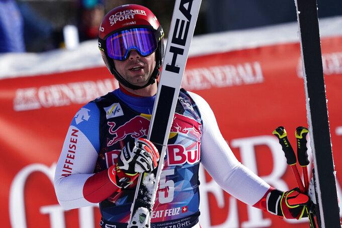 Switzerland's Beat Feuz reacts after completing an alpine ski, men's World Cup downhill in Kitzbühel, Austria, Friday, Jan. 22, 2021. (AP Photo/Giovanni Auletta)