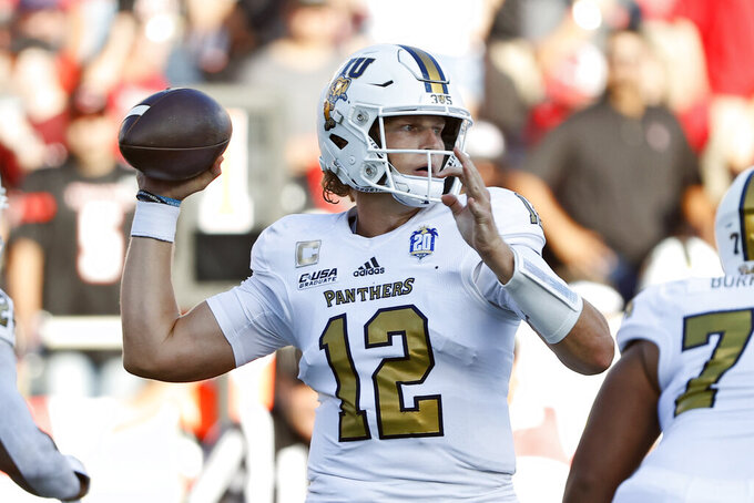 Florida International's Max Bortenschlager (12) passes the ball during the first half of an NCAA college football game against Texas Tech, Saturday, Sept. 18, 2021, in Lubbock, Texas. (AP Photo/Brad Tollefson)