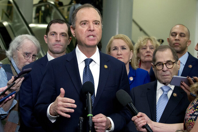 House Intelligence Committee Chairman Adam Schiff, D-Calif., accompanied by the impeachment managers House Judiciary Committee Chairman, Rep. Jerrold Nadler, D-N.Y., Rep. Hakeem Jeffries, D-N.Y., Rep. Sylvia Garcia, D-Texas, Rep. Zoe Lofgren, D-Calif., and Rep. Jason Crow, D-Colo. speaks to reporters, on Capitol Hill in Washington, Wednesday, Jan. 22, 2020. The U.S. Senate was poised to hear opening arguments Wednesday in President Donald Trump's impeachment trial, with Democratic House managers set to make their case that Trump abused power and should be removed from office.(AP Photo/Jose Luis Magana)