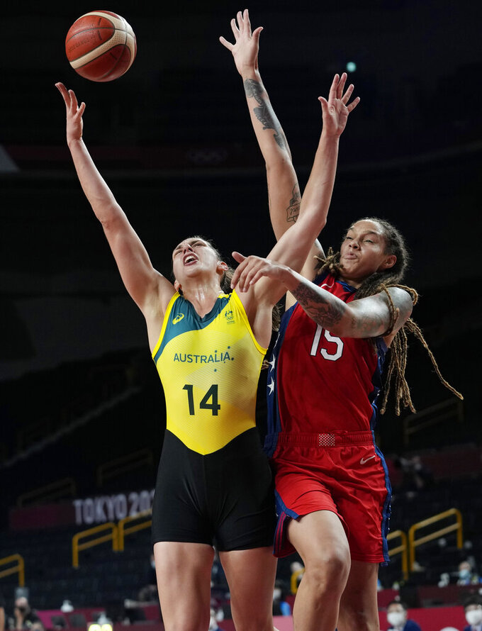 Australia's Marianna Tolo (14) drives to the basket against United States's Brittney Griner (15) during a women's basketball quarterfinal game at the 2020 Summer Olympics, Wednesday, Aug. 4, 2021, in Saitama, Japan. (AP Photo/Eric Gay)