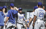 Los Angeles Dodgers' Max Muncy, center, celebrates with teammates after the Dodgers defeated the San Francisco Giants in a baseball game in San Francisco, Sunday, June 9, 2019. (AP Photo/Jeff Chiu)