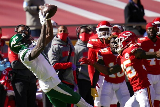 New York Jets wide receiver Denzel Mims (11) catches a pass in front of Kansas City Chiefs cornerback Charvarius Ward (35) in the first half of an NFL football game on Sunday, Nov. 1, 2020, in Kansas City, Mo. (AP Photo/Jeff Roberson)