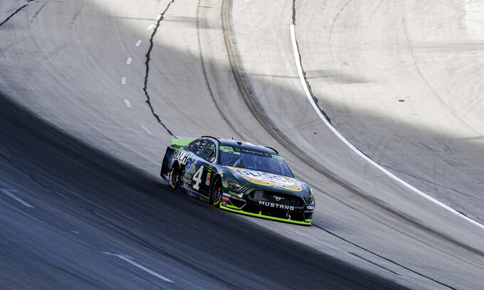 Kevin Harvick (4) leads the field into turn one during a NASCAR auto race at Texas Motor Speedway, Sunday, Nov. 3, 2019, in Fort Worth, Texas. Harvick would win the race. (AP Photo/Larry Papke)