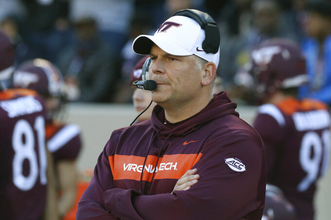 Virginia Tech head coach Justin Fuente looks on from the bench at the start of an NCAA college football game against Miami in Blacksburg, Va., Saturday, Nov. 17 2018. (Matt Gentry/The Roanoke Times via AP)