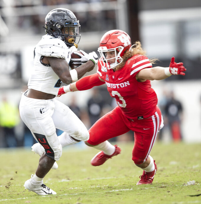 Central Florida running back Otis Anderson (2) runs past Houston safety Grant Stuard (3) during the second half of an NCAA college football game in Orlando, Fla., Saturday, Nov. 2, 2019. (Photo/Willie J. Allen Jr.)