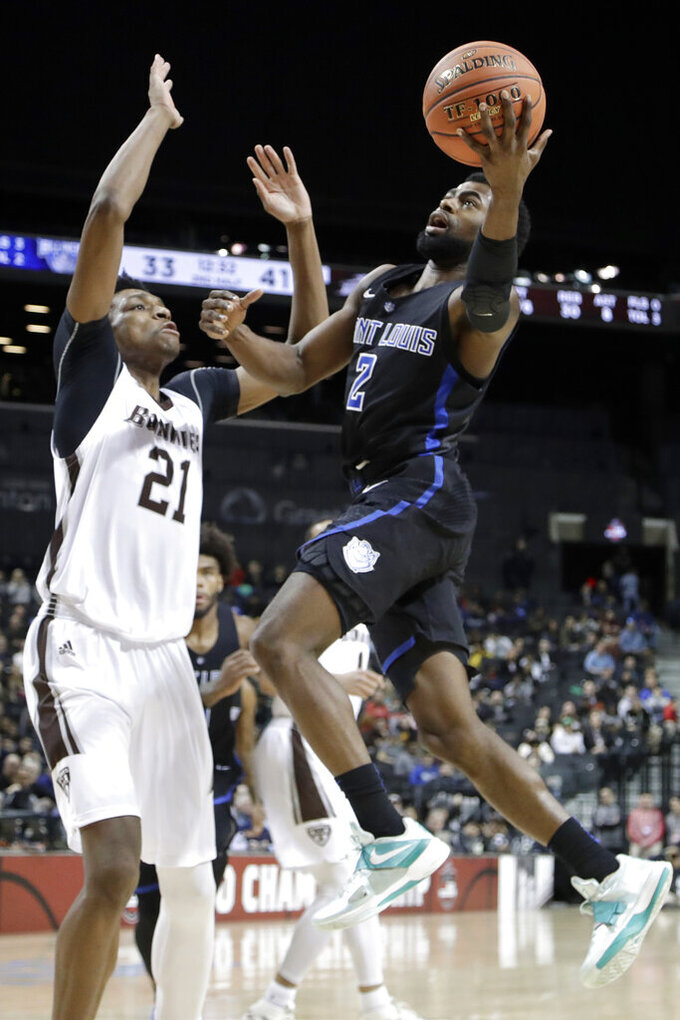 Saint Louis guard Tramaine Isabell Jr. (2) goes up for a shot against St. Bonaventure forward Osun Osunniyi (21) during the second half of an NCAA college basketball game in the Atlantic 10 men's tournament final Sunday, March 17, 2019, in New York. Saint Louis won 55-53. (AP Photo/Julio Cortez)