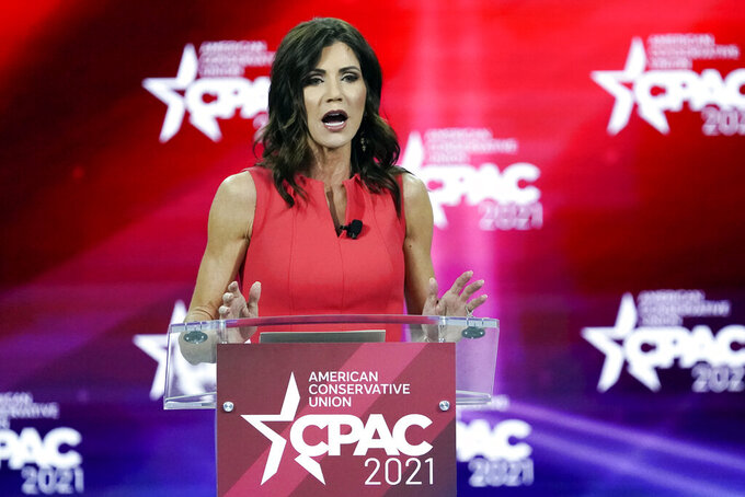 FILE - In this Feb. 27, 2021, file photo, South Dakota Gov. Kristi Noem speaks at the Conservative Political Action Conference (CPAC) in Orlando, Fla. Gov. Noem sued the U.S. Department of Interior on Friday, May 30, 2021, in an effort to see fireworks shot over Mount Rushmore National Monument on Independence Day. The Republican governor successfully pushed last year for a return of the pyrotechnic display after adecade longhiatus. (AP Photo/John Raoux, File)