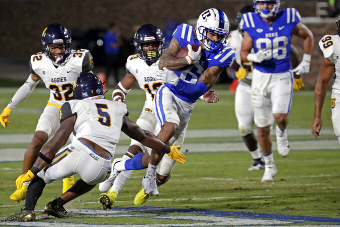 Duke wide receiver Eli Pancol (6) runs the ball upfield against North Carolina A&T linebacker Richie Kittles (5) after making a catch during the second half of an NCAA college football game in Durham, N.C., Friday, Sept. 10, 2021. (AP Photo/Chris Seward)