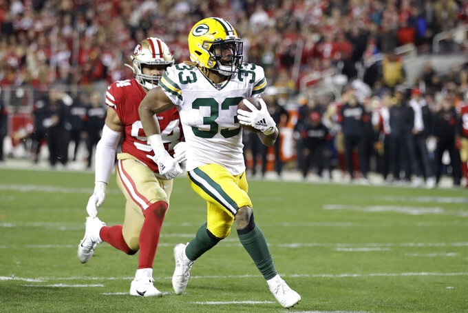 Green Bay Packers running back Aaron Jones (33) runs for a touchdown in front of San Francisco 49ers defensive end Solomon Thomas during the second half of the NFL NFC Championship football game Sunday, Jan. 19, 2020, in Santa Clara, Calif. (AP Photo/Ben Margot)