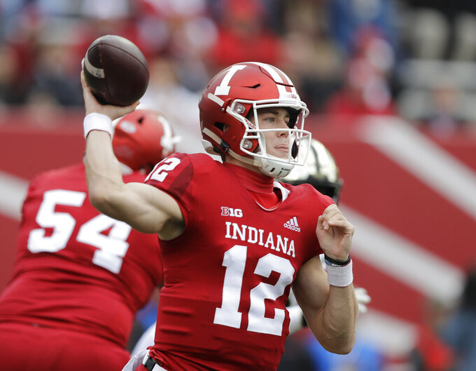 FILE - In this Saturday, Nov. 24, 2018, file photo, Indiana quarterback Peyton Ramsey throws during the first half of an NCAA college football game against Purdue, in Bloomington, Ind. A big reason for Northwestern's struggles on offense last season was the play of the quarterbacks. Northwestern got help in March when Peyton Ramsey announced he was transferring from Indiana. (AP Photo/Darron Cummings, File)
