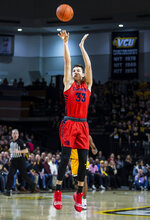 Dayton forward Ryan Mikesell (33) takes a shot during the first half of an NCAA college basketball game against VCU, Tuesday, Feb. 18, 2020, in Richmond, Va. (AP Photo/Zach Gibson)