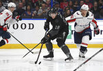 Tampa Bay Lightning left wing Ondrej Palat (18) handles the puck against Washington Capitals left wing Carl Hagelin (62) during the second period of an NHL hockey game Saturday, March 16, 2019, in Tampa, Fla. (AP Photo/Jason Behnken)