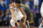 Saint Mary's guard Tommy Kuhse (12) tries to steal the ball from Long Beach State guard Michael Carter III (1) during the first half of an NCAA college basketball game Thursday, Nov. 14, 2019, in Moraga, Calif. (AP Photo/D. Ross Cameron)