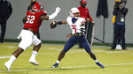 Liberty quarterback Malik Willis (7) prepares to pass as North Carolina State defensive tackle C.J. Clark (52) closes in during the first half of an NCAA college football game Saturday, Nov. 21, 2020, in Raleigh, N.C. (Ethan Hyman/The News & Observer via AP, Pool)