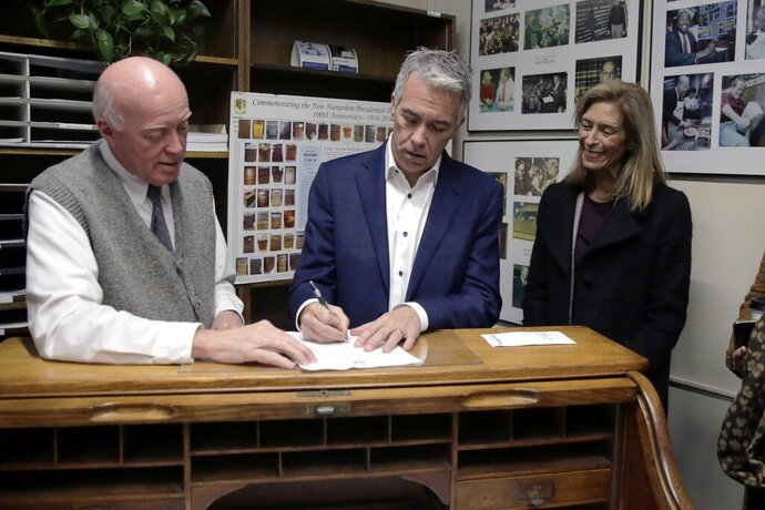 Republican presidential candidate former U.S. Rep. Joe Walsh, R-Ill., files to have his name listed on the New Hampshire primary ballot, Thursday, Nov. 14, 2019, in Concord, N.H. At left is New Hampshire Secretary of State Bill Gardner and at right is his wife Helene Walsh. (AP Photo/Charles Krupa)