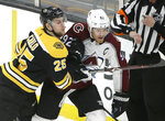 Boston Bruins' Brandon Carlo (25) crashes into Colorado Avalanche's Gabriel Landeskog (92), of Sweden, during the second period of an NHL hockey game, Sunday, Feb. 10, 2019, in Boston. (AP Photo/Steven Senne)