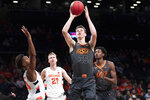Oklahoma State forward Hidde Roessink (35) goes to the basket past Syracuse forward Marek Dolezaj (21) and forward Elijah Hughes (33) during the first half of an NCAA college semi final basketball game in the NIT Season Tip-Off tournament, Wednesday, Nov. 27, 2019, in New York. (AP Photo/Mary Altaffer)