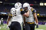 Appalachian State wide receiver Thomas Hennigan, right, celebrates a touchdown against UAB with offensive lineman Ryan Neuzil (58) during the second half of the New Orleans Bowl NCAA college football game in New Orleans, Saturday, Dec. 21, 2019. (AP Photo/Brett Duke)
