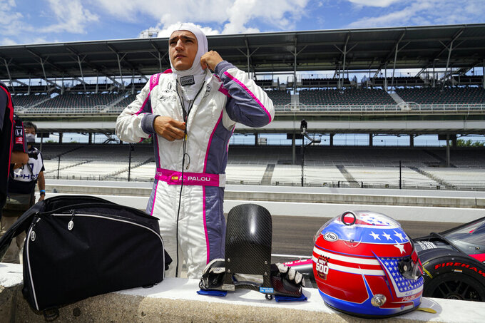 FILE -In this Aug. 14, 2020, file photo, Alex Palou, of Spain, prepares to drive during practice for the Indianapolis 500 auto race at Indianapolis Motor Speedway in Indianapolis. Palou is moving to Chip Ganassi Racing to fill Felix Rosenqvist's seat, who has been hired by Arrow McLaren SP for the 2021 IndyCar season. (AP Photo/Michael Conroy, File)