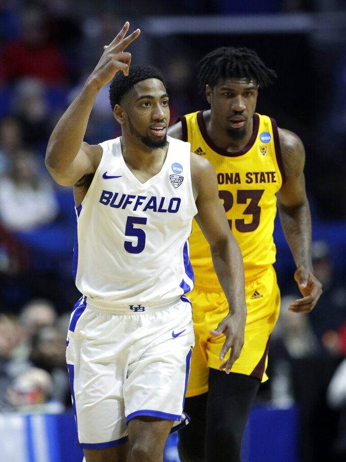 Buffalo's CJ Massinburg (5) celebrates after making a shot during the first half of a first round men's college basketball game against Arizona in the NCAA Tournament Friday, March 22, 2019, in Tulsa, Okla. (AP Photo/Charlie Riedel)