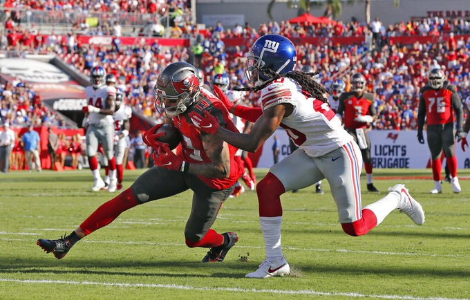 Tampa Bay Buccaneers wide receiver Mike Evans (13) beats New York Giants cornerback Janoris Jenkins (20) to the endzone to score his third touchdown during the first half of an NFL football game Sunday, Sept. 22, 2019, in Tampa, Fla. (AP Photo/Mark LoMoglio)