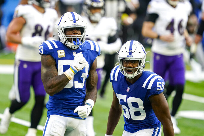 Indianapolis Colts outside linebacker Darius Leonard (53) and inside linebacker Bobby Okereke (58) celebrate a stop against the Baltimore Ravens in the first half of an NFL football game in Indianapolis, Sunday, Nov. 8, 2020. (AP Photo/Darron Cummings)