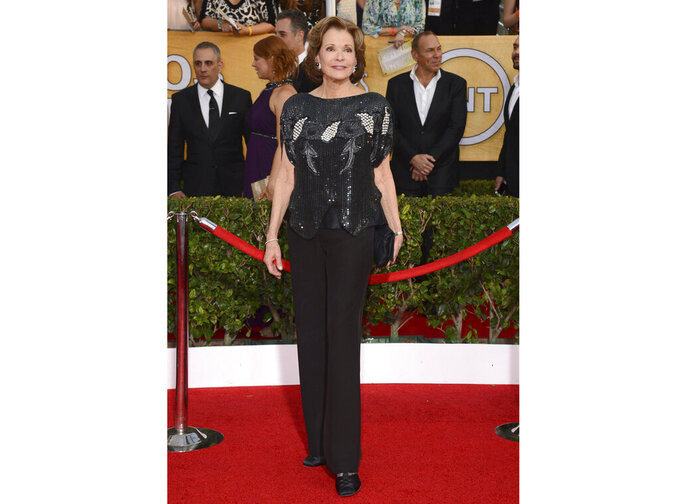 """FILE - Jessica Walter arrives at the 20th annual Screen Actors Guild Awards on Jan. 18, 2014, in Los Angeles. Walter, who played a scheming matriarch in TV's """"Arrested Development,"""" has died. She was 80. Walter's death was confirmed Thursday, March 25, 2021, by her daughter, Brooke Bowman. The actor's best-known film roles included playing the stalker in Clint Eastwood's 1971 thriller, """"Play Misty for Me."""" (Photo by Jordan Strauss/Invision/AP, File)"""