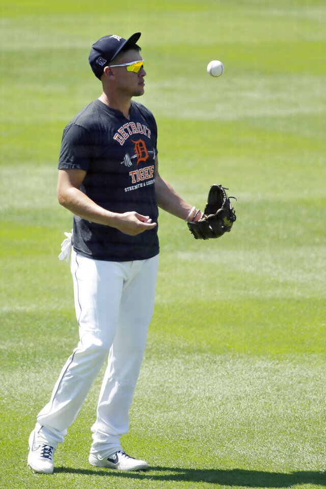 Detroit Tigers' JaCoby Jones flips a baseball during baseball training camp at Comerica Park, Friday, July 3, 2020, in Detroit. (AP Photo/Duane Burleson)