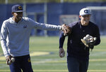 In this photo taken March 6, 2019, California's Darren Baker, left, laughs with Andrew Vaughn during baseball practice in Berkeley, Calif. Vaughn is a projected high first-round pick in this June's amateur draft. Scouts are flocking to Berkeley and beyond to watch Vaughn from every angle this spring.  (AP Photo/Jeff Chiu)
