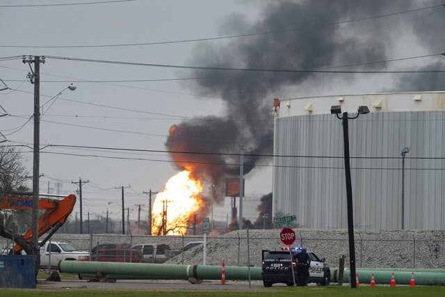 Corpus Christi police and fire departments respond to a large fire at Interstate Highway 37 and Buddy Lawrence Drive, near the Citgo Refinery Monday, Feb. 17, 2020. (Courtney Sacco/Corpus Christi Caller-Times via AP)