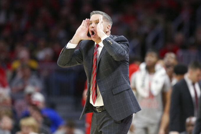 Ohio State head coach Chris Holtmann calls out a play against West Virginia during the first half of an NCAA college basketball game Sunday, Dec. 29, 2019, in Cleveland. West Virginia defeated Ohio State 67-59. (AP Photo/Ron Schwane)(AP Photo/Ron Schwane)